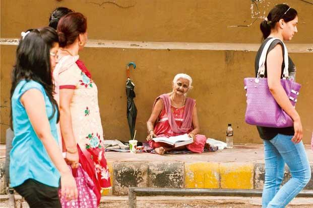 Ramrati, clad in a pink gown, can be found every morning in the lane connecting New Delhi's Barakhamba Road to Kasturba Gandhi Marg, reading the 'Ramcharitmanas'. Photos: Sneha Srivastava/Mint