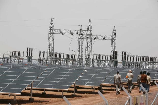 A file photo of solar panels in Gujarat. To start with, the government plans to provide viability gap funding (VGF) of <span class='WebRupee'>Rs.</span>1,000 crore for setting up grid-connected solar projects of 1,000MW capacity by the Indian Army, which would provide electricity to one of the largest consumers in the country at a tariff of <span class='WebRupee'>Rs.</span>5.50 per unit.