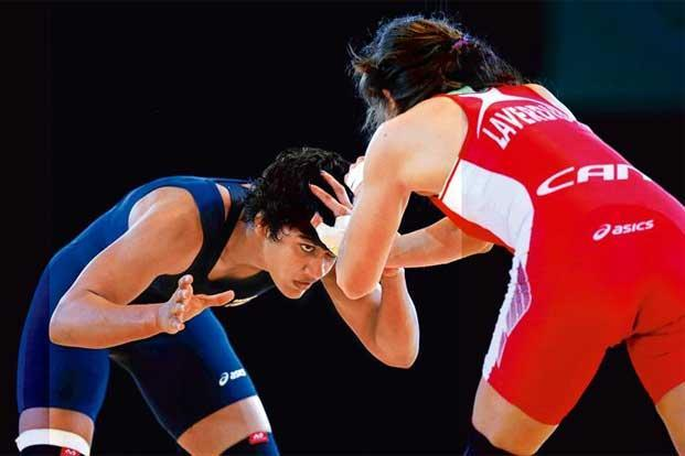 Vinesh Phogat (left) on her way to winning a gold at the 2014 Commonwealth Games. Photo: Alex Livesey/Getty Images