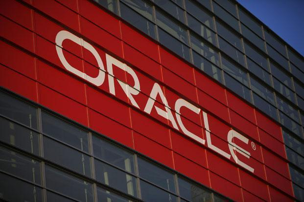 In fiscal 2015, Oracle is introducing performance stock units, which are awarded to Larry Ellison, Safra Catz and Mark Hurd based on how well the company does in terms of cash flow and revenue growth compared with technology peers. Photo: Reuters