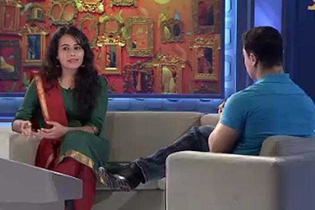 Aamir Khan talks to Gazal Dhaliwal (left) during the show. Dhaliwal was born male, but realized at a young age that she wanted to be female.