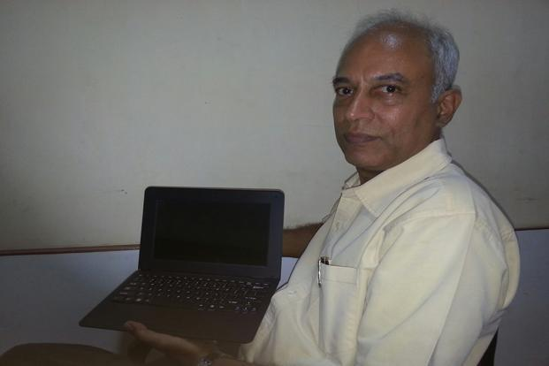 Kannan M. Moudgalya, professor of chemical engineering at IIT-B, with the netbook developed by the institute.