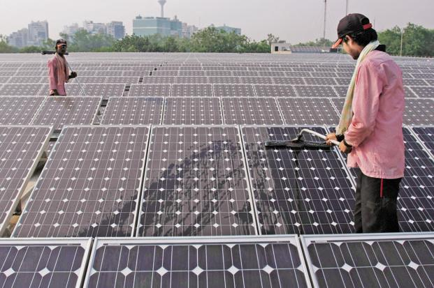 India's National Action Plan on Climate Change recommends that the country generate 10% of its power from solar, wind, hydropower and other renewable sources by 2015 and 15% by 2020. Photo: Bloomberg