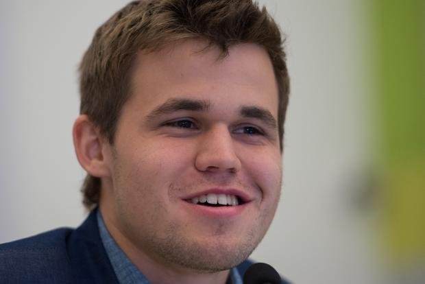 Norway&#39;s <b>Magnus Carlsen</b> smiles after his victory in 11th game over former <b>...</b> - carlsenmagnus-kAyD--621x414%40LiveMint