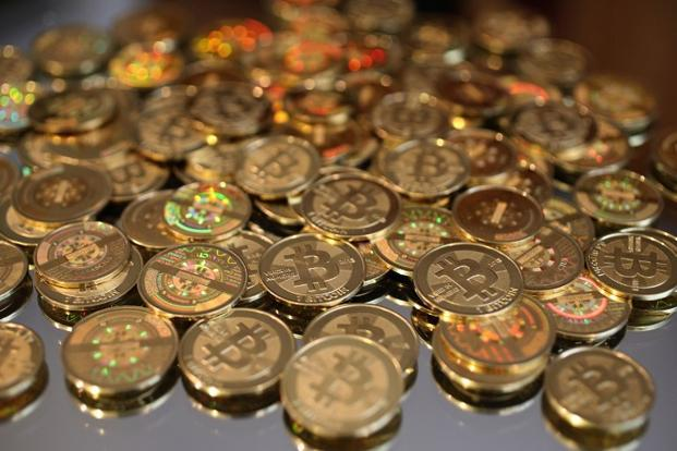 Cryptocurrencies like bitcoin can disaggregate, decentralize and disintermediate financial services. Photo: AFP