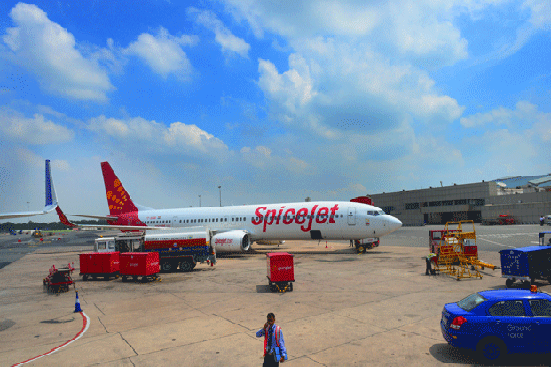 On Thursday, shares of SpiceJet rose 3.04% to <span class='WebRupee'>Rs.</span>18.65 on BSE, while the exchange's benchmark Sensex rose 2.66% to close at 28,075.55 points. Photo: Ramesh Pathania/Mint