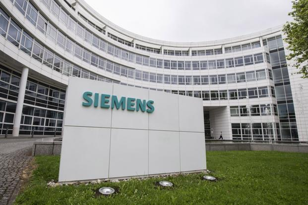 Siemens' CEO said last year that it needs to eliminate jobs to slash about €1 billion in costs by creating a leaner divisional structure and simplifying regional operations. Photo: Reuters