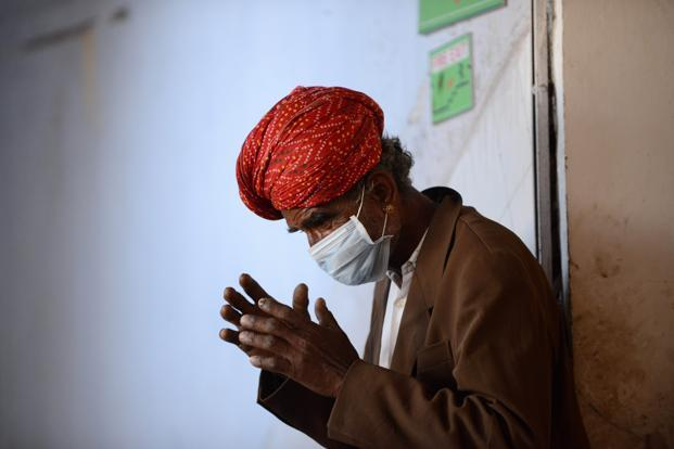 File photo. An Indian relative of a patient receiving treatment waits outside the swine flu isolation ward of the Ahmedabad Civil Hospital in Ahmedabad. Photo: AFP