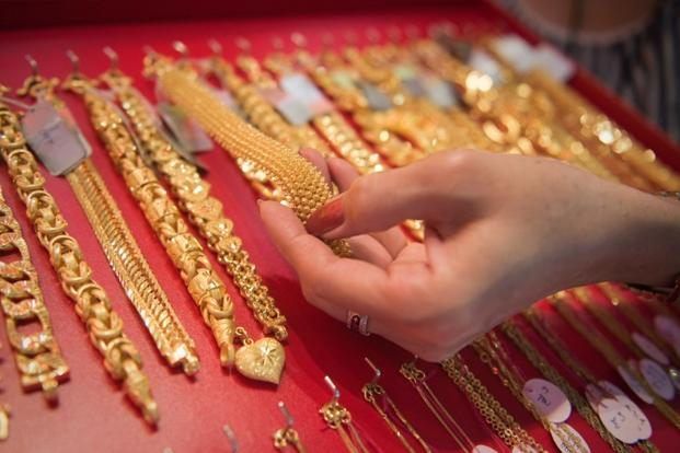 Gold in New York, which normally sets price trend on the domestic front, fell to $1,197.70 an ounce. Photo: AFP
