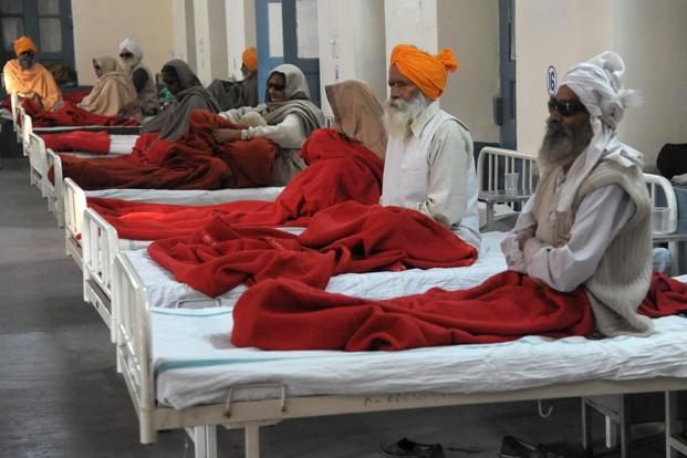 Patients, who lost their eyesight after undergoing a free cataract surgery, rest in a ward of a government hospital. Photo: AFP