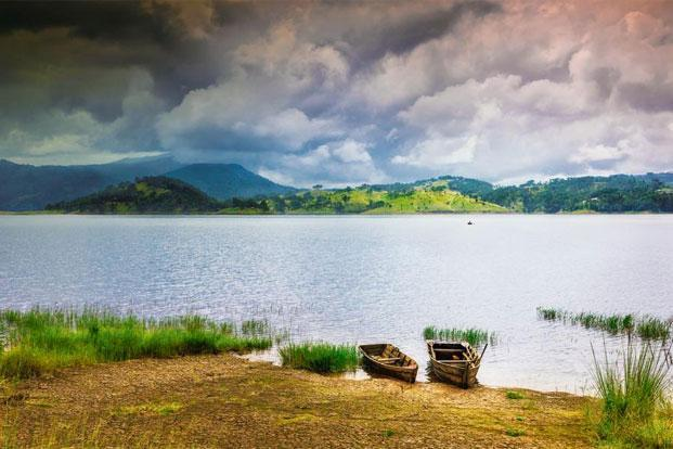 Boats moored on Umiam Lake as clouds gather over the Khasi Hills near Shillong. Photo: Alamy/India Picture (Alamy/India Picture)