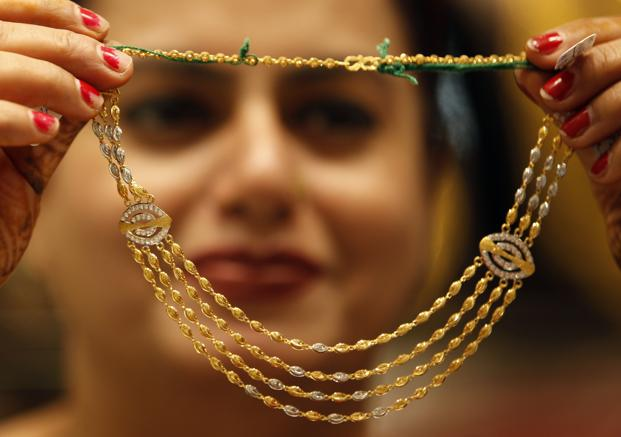 Gold in New York, which normally determines price trend on the domestic front, dropped by $29.30, or 2.45%, to 1,168.70 an ounce. Photo: Hindustan Times