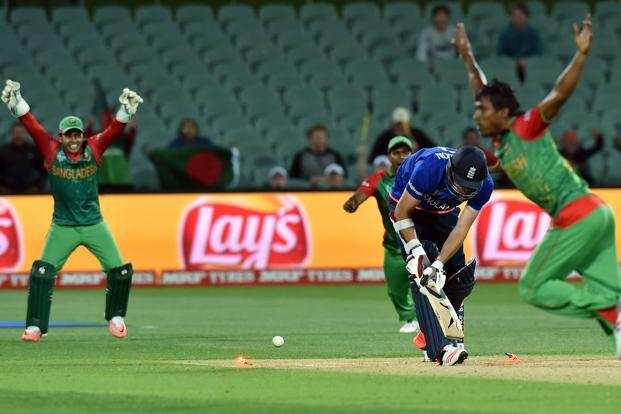 Bangladesh paceman Rubel Hossain (R) celebrates the final wicket of England's James Anderson (C) in Monday's match in Adelaide. Photo: Saeed Khan/AFP (Saeed Khan/AFP)