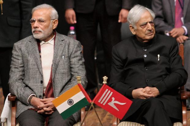 Narendra Modi (left) has to find some middle path that enables him to set down his own roots and his own authority in the troubled state, else he join the list of prime ministers who have made no headway in Kashmir. Photo: PTI (PTI)
