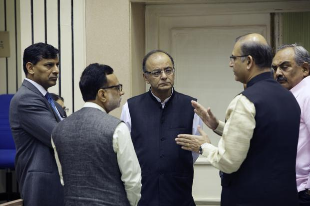 Raghuram Rajan (left) and finance minister Arun Jaitley (centre), listen as minister of state for finance Jayant Sinha (second from right), speaks at the launch of the Mudra Bank in New Delhi on 8 April. Photo: Bloomberg