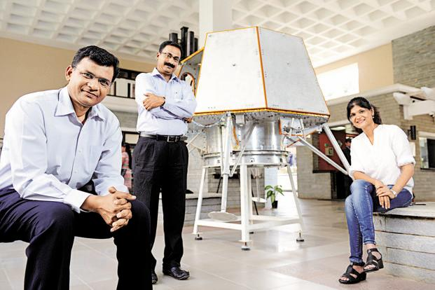 (From left) Rahul Narayan, Team Indus fleet commander; Ramnath Babu, Team Indus Jedi master for structures; and Sheelika Ravishankar, Team Indus Jedi master for people capital, with a prototype lunar lander that is designed to send data and photos from the moon to Earth. Photo: Hemant Mishra/Mint