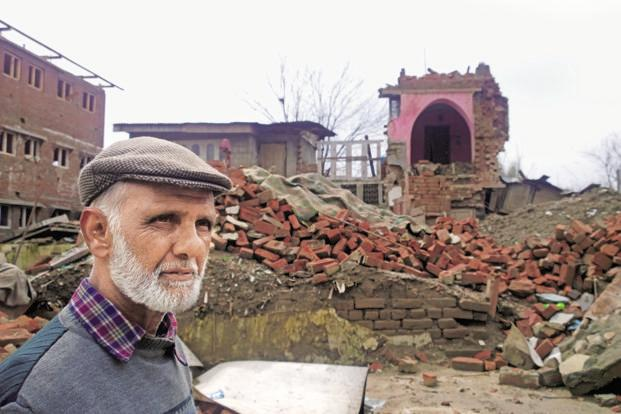 Mohammed Muzaffar Bhat, 69, in front of his house that was destroyed by the September floods, in Jawahar Nagar, Srinagar. Photo: Ananda Banerjee/Mint