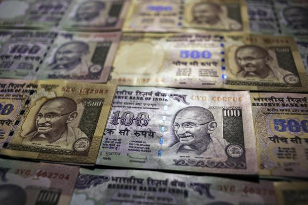 Rupee opens higher at 63.47 per dollar