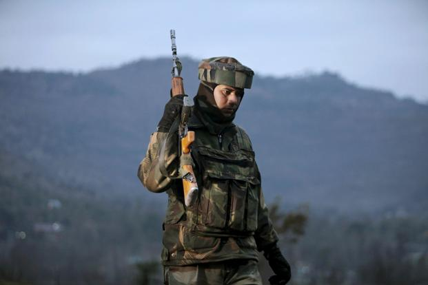 An Indian Army soldier patrols near the line of control, the line that divides Kashmir between India and Pakistan, after a reported cease-fire violation, in Mendhar, Poonch district. Photo: AP