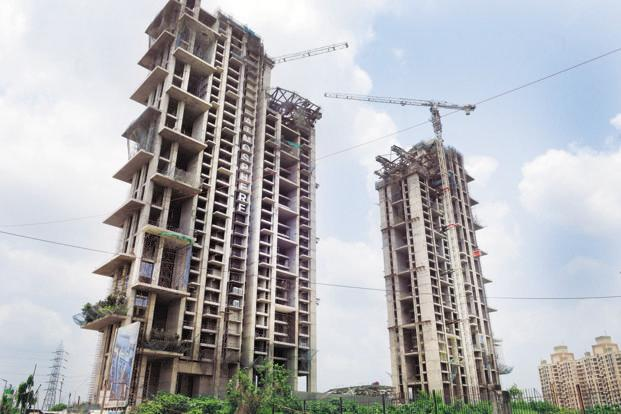 Squeezed real estate firms eye asset sales, tie-ups
