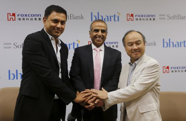 Masayoshi Son (right), founder and chief executive officer of Japan's SoftBank Corp., Nikesh Arora (left), president of Japan's SoftBank Corp. and Sunil Bharti Mittal, chairman of Bharti Enterprises, shake hands before the start of a news conference in New Delhi on Monday. Photo: Reuters