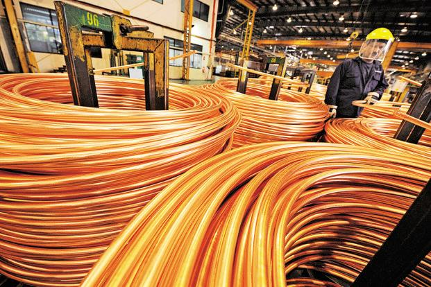 A file photo of a worker rolling copper wire into  coils. The share of algo trades in commodities such as copper rose to 30% from 3% in January. Photo: Bloomberg