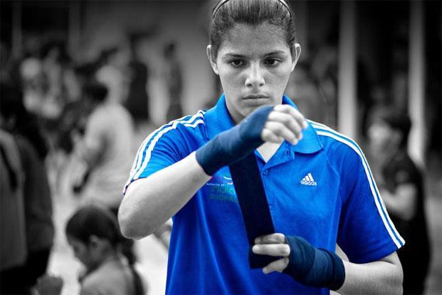 Junior women's boxing world champion Sakshi gets ready for a training session. Photographs: Priyanka Parashar/Mint