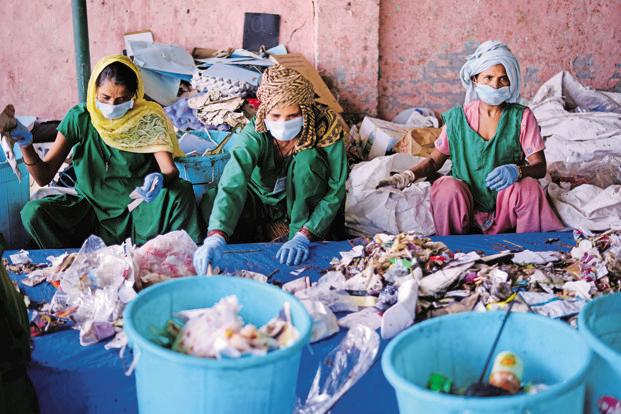 A file photo of workers with Chintan, an NGO that works with waste pickers. Photo: Pradeep Gaur/Mint