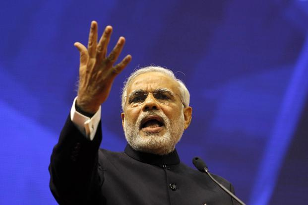 In Narendra Modi's India, billionaires and businesses learn their place