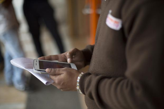 With smartphone proliferation, ICT can play a significant role in shaping sustainable growth in India, while addressing issues such as poverty, pollution, job creation and resource shortage. Photo: Bloomberg