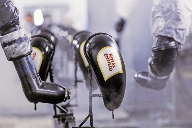 Robotic arms spray lacquer on gas tanks for Royal Enfield motorcycles at the company's plant in Tamil Nadu. Photo: Bloomberg