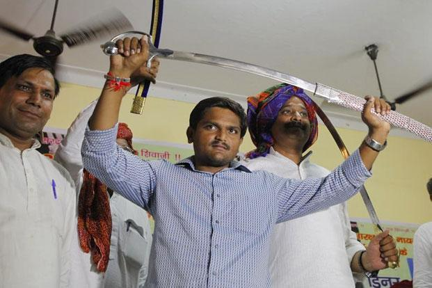 By oscillating from Gandhiji's non-violent beliefs to Bhagat Singh and Chandra Shekhar Azad's not so peaceful ways of protest, by toting guns, swords and roses, Hardik Patel has given us a reverse lesson in dressing. Photographs: Arvind Yadav/ Hindustan Times