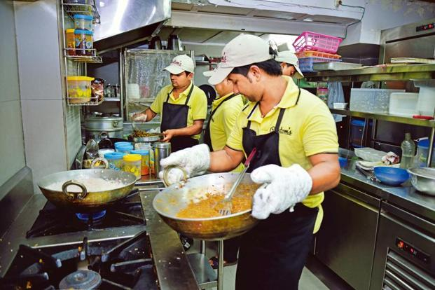 Every one of the kitchen staff at Rustom's Parsi Bhonu, New Delhi, picked up their skills on the job. Photo: Hemant Mishra/Mint