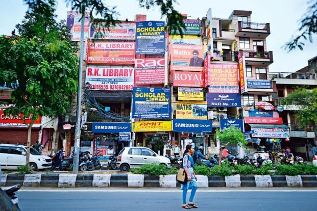Signboards of  various coaching institutes cover the facade of this building.