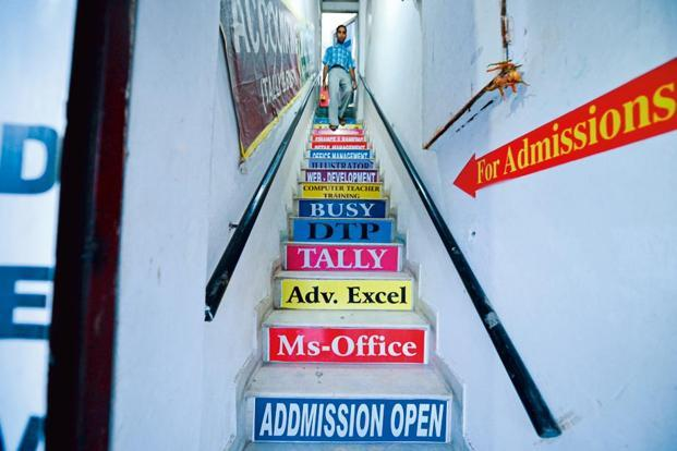 Even staircases are used for advertising coaching institutes.