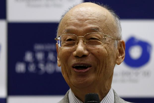 Satoshi Omura smiles as he speaks during a news conference in Tokyo on 5 October. Photo: Reuters