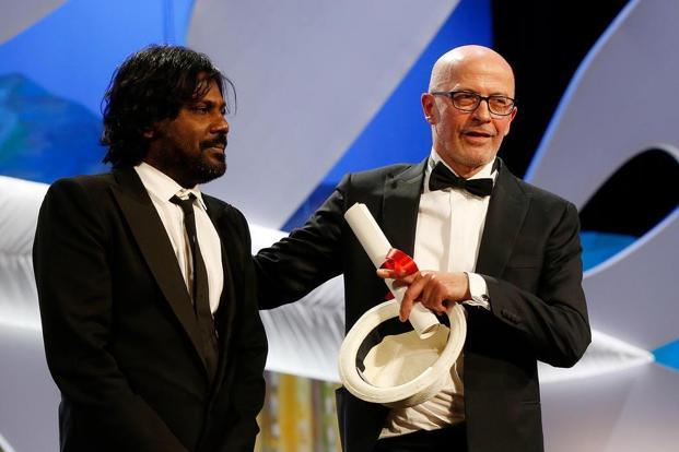 Director Jacques Audiard and actor Antonythasan Jesuthasan (left)