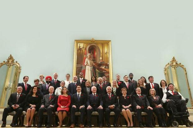 The 30-person new cabinet has as many women as men. Photo: Chris Wattie/Reuters