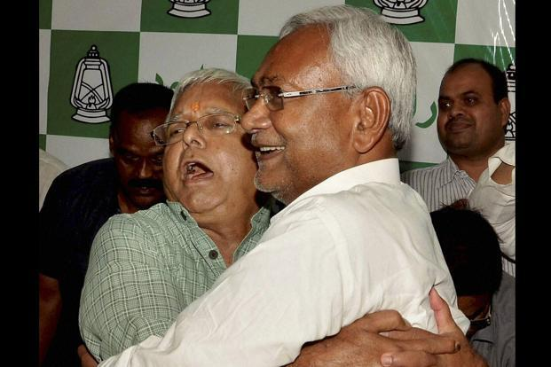 RJD chief Lalu Prasad and JD(U) leader Nitish Kumar after the election results in Patna on Sunday. Photo: PTI