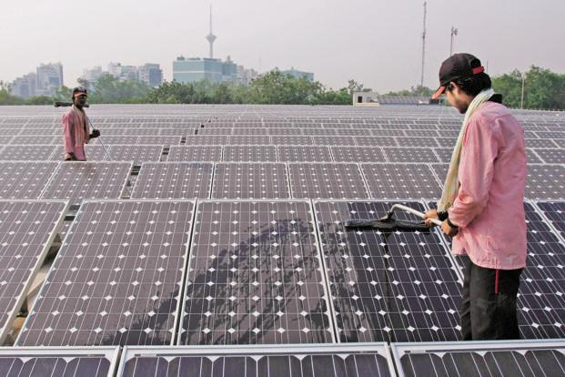 India aims to reduce the emission intensity of its gross domestic product by 33-35% by 2030 from 2005, and solar power is likely to contribute 4% towards this target. Photo: Bloomberg