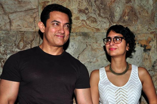 A file photo of actor Aamir Khan with wife Kiran Rao. The Congress, Left, Samajwadi Party and Aam Aadmi Party backed the actor, with Rahul Gandhi tweeting that the Centre should 'reach out to people' and not bully them. Photo: AFP