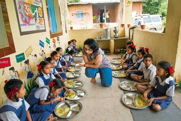 An Edelweiss employee interacting with schoolchildren in Wada district, Maharashtra. Photo: Aniruddha Chowdhury/Mint