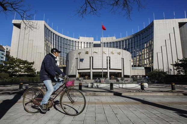 A file photo of the PBoC headquarters in Beijing. After six rate cuts since late last year failed to spur a faster expansion and exports posted a fifth-straight monthly drop, the PBoC is changing tactics. Photo: Bloomberg