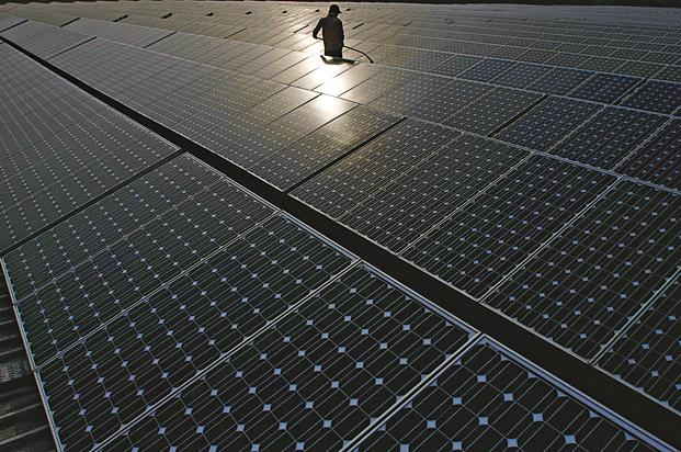 India has raised its 2022 solar energy target to 100GW from 20GW as part of the Narendra Modi-led National Democratic Alliance government's efforts to lower dependence on coal-fuelled electricity. Photo: Bloomberg