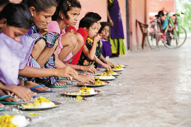 The enrolment of children in schools providing mid-day meals was showing a consistent decline, according to a CAG report. The number of children enrolled in schools covered by the scheme has come down to 138.7 million from 146.9 million in 2009-10. Photo: Mint