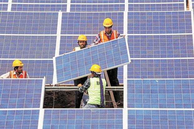 Though coal will continue to be India's main source of power, solar power will account for around 18% of it by 2030 compared with only 1% at present. Photo: Sam Panthaky/AFP