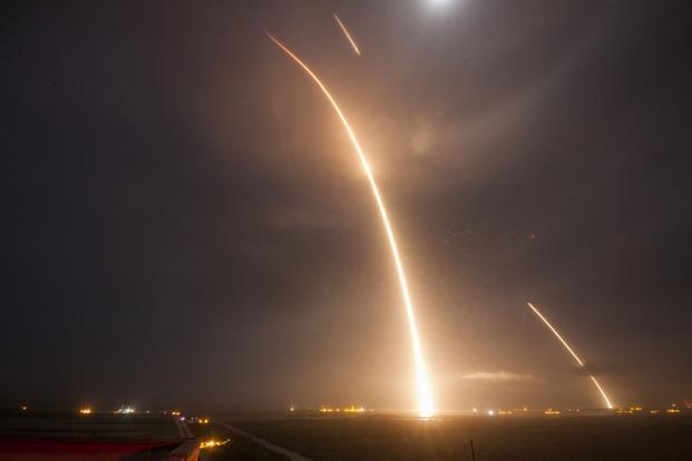 SpaceX employees erupted in jubilation as they watched live video footage of the 156-foot-tall white first-stage booster slowly descending upright through a damp, darkened night sky amid a glowing orange ball of light to make a picture-perfect landing.  Photo: AFP/SpaceX