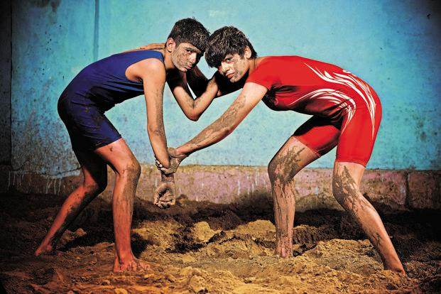 Wrestling sisters Mansi Ahlawat (in Red) and Khushi Ahlawat (in Blue) come from a rural Haryana but they aim high— they want to win the Olympic medal. This photo was a part of our aspiration series of stories. Photo by Priyanka Parashar on 09 November 2015.
