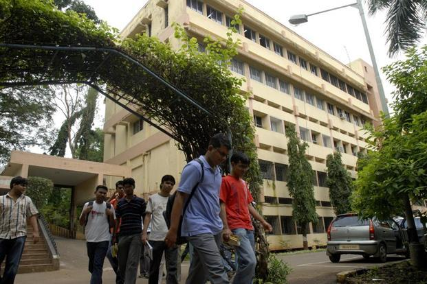 National Institute of Industrial Engineering. Mumbai Students coming out of their classroom. Main building seen behind.