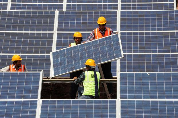 India has an ambitious solar power programme under the National Solar Mission, which is aimed at adding 100,000MW of solar power by 2022. Photo: AFP